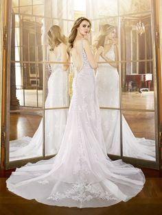 Wedding Dresses:   Illustration   Description   Head over heels for the back of this wedding dress that transitions into a low illusion deep v accented with alluring draped layers of beading from  Moonlight Bridal    -Read More –   - #WeddingDresses https://adlmag.net/2018/01/01/wedding-dresses-inspiration-head-over-heels-for-the-back-of-this-wedding-dress-that-transitions-into-a-low-i/