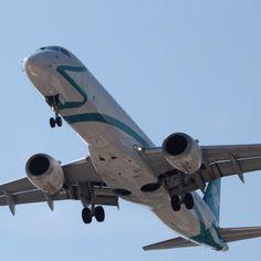 Embraer 195 Air Dolomiti landing Bologna airport Italy