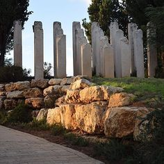 Severed pillars of varying heights symbolizing the life that was brutally cut off before its time; part of the landscape surrounding the Children's Memorial at Yad Vashem, in memory of the 1.5 million Jewish children murdered in the Holocaust.