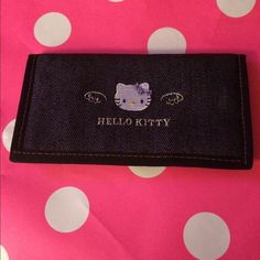 Hello Kitty  check book wallet Like new with no tags Hello Kitty Wallet denim look material . Item comes from smoke fee home . Helllo Kitty Accessories Key & Card Holders