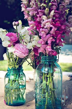 Mason Jars / Flowers | Photo: Captured by Aimee @ Style Me Pretty. http://www.stylemepretty.com/gallery/photo/359072
