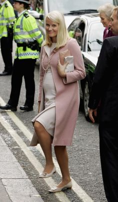 Mette-Marit, the Crown Princess of Norway, prevented a plain, cream-colored maternity dress from looking too drab by pairing it with a cheerful, salmon pink overcoat and a matching string of pearls. The blond royal, who has three children, was pregnant with her son Sverre Magnus when she wore this pastel confection to a literary luncheon in the U.K. in 2005. She was seven months pregnant.