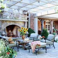Out door fireplace under a big old pergola