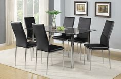 Create a fashionably dramatic eating space with this seven-piece Koda dining package. Adding a bright touch to your dining room, the silver-finished steel table and chair bases provide sturdy support for all your family dinners. Rich, black faux leather upholstery is stretched over the high-density foam seat and back cushions for a comfortable place to sit. Plus, the gently curved seat backs and tempered glass tabletop elevate your home to a new, modern high.