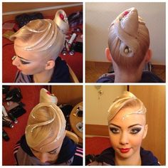 High knotted bun with a clean bang swoop and wisps. Good hairstyle or latin and standard ballroom. Visit http://ballroomguide.com/comp/hair_make_up.html for more hair and makeup info