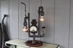 Steampunk Lamp with a 1914 Ford headlight as its centerpiece. The owner found it when he was 12 and now re-purposed into a fantastic steampunk lamp. Steampunk Hat, Antique Stores, Repurposed, Lamps, Centerpieces, Ford, Lights, Decorating, Antiques