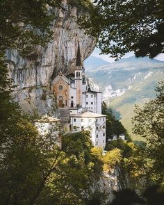 The Santuario Madonna della Corona church is dauntingly suspended over the cliffs of Verona, Italy Oh The Places You'll Go, Places To Travel, Places To Visit, Travel Pictures, Travel Photos, Travel Tips, Destinations, Le Shop, Famous Places
