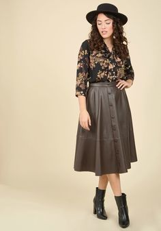 <p>The house party, the client meeting, the dinner date - nothing begins until you arrive in this faux-leather midi skirt! Offering a rich brown hue for versatility, dotted with decorative buttons, and equipped with side pockets, this edgy garment puts you at the top of the list every time.</p>