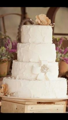 Rustic wedding cake. Love everything about this.  Add a little burlap and we have our cake!