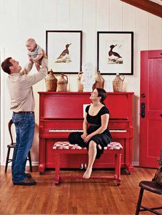 Mandy and Jim Black bought their piano for $100, painted it Mandy's favorite color, and topped it off with a white plaster bust of Elvis—a favorite of Jim's. A pair of 18th-century prints and antique wine jugs share space with the fun, kitschy statue. (Photo: Roger Davies)