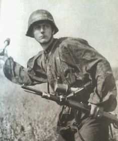 Finnish Waffen-SS volunteer Rolf Labbart throws a hand grenade. He was also actor and singer. Eastern front 1942-43. Pin by Paolo Marzioli