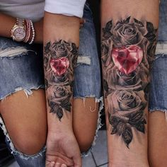 Beautiful Black and grey rose background with a pretty heart shaped ruby, done on girls forearm.