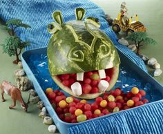 A fun watermelon hippo that would surely attract both playful adults and kids! There are instructions for every watermelon carving that comes out from the National Watermelon Promotion Board! Watermelon Animals, Fruit Animals, Jungle Theme Parties, Jungle Party, Jungle Theme Food, Jungle Safari, Safari Birthday Party, Animal Birthday, Adult Safari Party