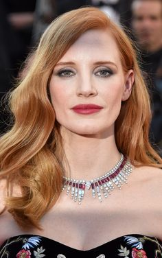 Jessica Chastain wore a heavily embroidered black strapless Alexander McQueen gown and Piaget high jewellery necklace from the Sunlight Journey collection, featuring ruby and diamond Art Deco vibes. With smokey eye, red lip, and Hollywood hair waves. For glamour celebrity fashion Cannes Film Festival red carpet jewellery spotting travel here: http://www.thejewelleryeditor.com/jewellery/top-5/cannes-film-festival-red-carpet-jewellery-day-one/ #jewelry