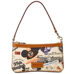 Dooney & Bourke Wristlet , $85 , 4 1/2'' H x 8'' W , Zip closure , Carrying strap with lobster claw clasp at one end ,  Fully lined  Interior compartment  ''Dooney & Bourke Since 1975'' leather label on front , Coated cotton with leather trim and metal hardware