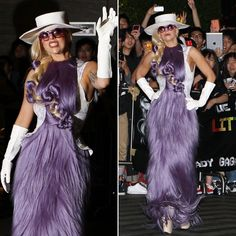Lady Gaga arrived in Hong Kong sporting a dress made entirely from what appears to be purple hair extensions. She accessorized with white elbow-length gloves, a white hat and her own hair (or, okay, more hair extensions) woven into the bodice of the dress.