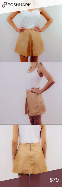 Alice & Olivia Tan Leather Skirt, Size 6 Alice & Olivia Tan Leather Skirt, Size 6. In near perfect condition, worn once! Tan/beige leather, hits high rise at the waist and flares out to a flattering A-line with a split panel in front and a zipper in back. Photos are of my actual item. Alice & Olivia Skirts Mini