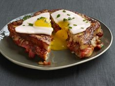 "French Toast with Bacon, Onion and Tomato Jam: Filled with cheese and bacon-tomato jam and topped with a perfectly fried egg. Anne Burrell's French-toast sandwich definitely skews on the savory side. She calls it an ""anytime dish."""