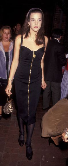 """Body-con corset dress, gold jewelry, wide black headband, and leopard-print pouchette ( Did Liv raid Elizabeth Hurley's closet? If Hurley wore this we'd be like, """"Omg. Whoa."""" But when Liv wore it, we're all like, """"Yes. Sold."""" )   Glamour.com slideshow of what Liv Tyler wore in the '90s that would work in 2015"""