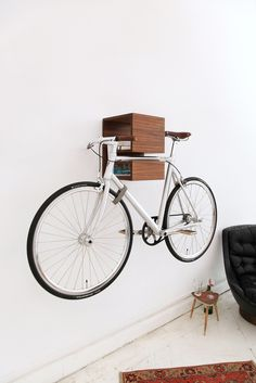 KAPPÔ, Bicycle Storage Solution by Mikili  The wall-mounted sculpture doubles as shelving for small books and knick-knacks as well as a disp...