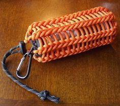 Vertical half hitching paracord pouch/can koozie... used a 30 foot length of orange paracord, with a couple of feet of black reflective paracord for the cinch cord with a cord lock, to make this paracord pouch/can koozie with vertical half hitching