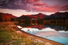"John De Bord  ""A Quiet Morning In Fall""  Photo thoughts--- It was so quiet that you never heard a thing except for the bugle of the Elk across the lake. Everything seemed to be at peace and at ease as I watched the sunrise along the shores of Lake Estes in Estes Park, Colorado this past Autumn. Tranquility in it's finest form with a cool very slight breeze to keep me company. The building in the background is the ..."