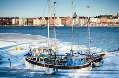 blue fishing boat in the ice, stockholm