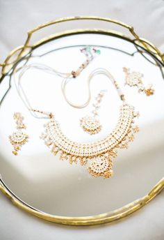 gold bridal statement necklace matching earrings | Photography: Birds of a Feather Photo
