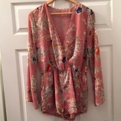 Gorgeous Dusty Rose Floral Romper NWOT This romper is fully lined, light, airy, and comfy. Floral print, dusty rose color, front crosses over for a sexy look. Sleeves are slightly flared. Waist is elastic. No tags inside but fits like a medium. NWOT. ❌NO TRADES ❌ NO LOWBALLING ❌ Boutique Dresses