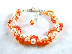 Orange Swarovski Fire Opal, Sunflower Crystals and White Crystal Pearl Silver Ashley Bracelet by UnicornGladeDesigns, $50.00