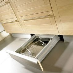 Toe-kick storage.    Modern kitchen by SVEA KITCHENS.  Houzz.