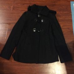 Guess jacket Guess jacket, zippers up the front and has two decorative toggle buttons, hood is removable, but 3 of the 5 buttons to attach are missing. Can easily be remedied by sewing on the three buttons. Size M. Reasonable offer will be accepted! Guess Jackets & Coats Pea Coats
