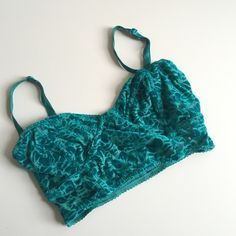 ADORABLE NOLLIE BRALETTE Adorable teal Nollie for urban outfitters bralette! Size XS with adjustable straps! Pretty velvet details all over. Gently worn only a few times, so it's still in awesome condition. Great under a cute tank or tee during the summer! ❤️ Urban Outfitters Intimates & Sleepwear Bras