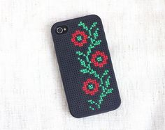 Buy a DIY cross-stitch case here and here.  Source: Etsy user skrynka