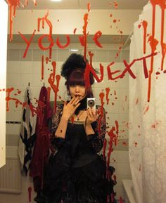 Decorate mirror with red paint to creep out halloween guests.