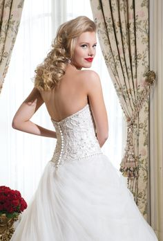 Justin Alexander wedding dresses style 8755 Tulle, beading over satin ball gown embellished with a strapless neckline.