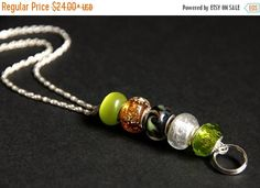 MOTHERS DAY SALE Badge Lanyard. Olive Green Id Lanyard. Green and Amber Badge Necklace. Beaded Badge Holder. Lampwork Glass Lanyard. Handmad by Gilliauna from Bits n Beads by Gilliauna. Find it now at http://ift.tt/2re2a1X!