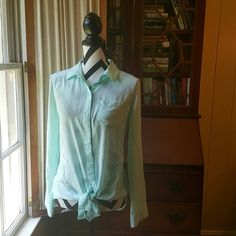 """Button Up Blouse That Ties In The Front Offers Always Welcome   This top is not only lightweight it feels soft and silky and looks so cute with shorts and flip flops. - 100% Rayon - Shoulder 15"""" - Bust 25 """" - Sleeve 12""""  - Front Length 27"""" Old Navy Tops Button Down Shirts"""