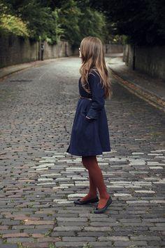 Coat, tights, hair.