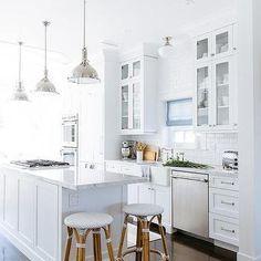 White Kitchen with White Beveled Subway Tile Backsplash