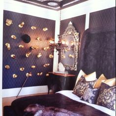 In no way would I have gold hands mounted on wall, but I do love the purple color.