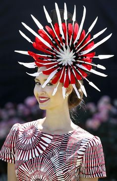 Chloe Moo from Sydney won the Fashions on Field at the Melbourne Cup 2013 Millinery created by Melissa Cabot.