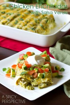 Enchilada  with Salsa Verde, Chicken and Cheese by A Spicy Perspective. Creamy Enchilada Recipe loaded with fresh Salsa Verde, piles of cheese, and juicy chicken. A wonderfully zesty dish the whole family will love!