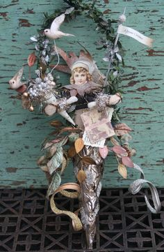 Aglitter birds and nests in cone wreath by Ashley Carter of Goldbug Studio.