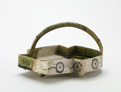 Serving dish in shape of overlapping fans, Mino ware, Oribe type early 17th century   Momoyama or Edo period  Stoneware with iron decoration under feldspathic glaze, and copper-green glaze H: 14.3 W: 28.2 D: 28.2 cm Japan