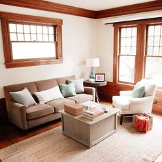 """This living room makeover was achieved to the tune of $350. The colorful design was inspired by items already in the space, proving that working with what you have and adding a little """"oomph"""" is the formula for decorating a l"""