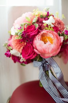 Bright pink bouquet: http://www.stylemepretty.com/2015/04/08/whimsical-colorful-london-gallery-wedding/   Photography: Caught the Light - http://caughtthelight.com/