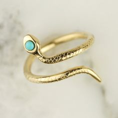 Hoard Jewelry https://www.etsy.com/listing/257011240/solid-14k-18k-gold-turquoise-snake
