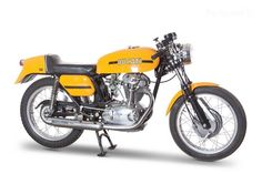 1970 ducati 350 desmo - DOC453089n In 1968, the wide-case 350-cc Mark 3 Desmo was the fastest production Ducati one could buy, with 103 mph on tap, or 112 mph with a noisier megaphone pipe. There were several options: high touring bars instead of clip-ons and even a racing kit with more radical camshaft, fairing a range of main jets and megaphone exhaust. The bike was unmistakable with early examples having twin filler caps on the fuel tank.
