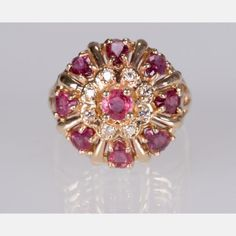 A 14kt. Yellow Gold, Diamond and Ruby Cocktail Ring, Having eight round brilliant cut diamonds, measuring 1.95-1.95x1.17mm and with a total weight of 0.22ct